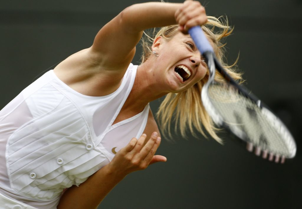 Maria Sharapova of Russia serves to Stephanie Foretz of France during their match at the Wimbledon tennis championships in London